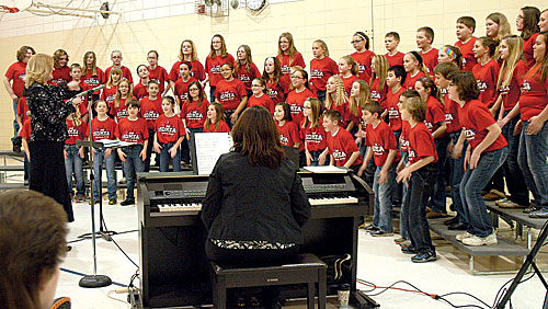 The area members of the Festival Chorus sponsored by the South Dakota Music Educators Association performed for the public Monday, March 4, in the Mobridge-Pollock Middle School gym. Members werefourth through sixth-graders from various schools in the region. The chorus was directed by Dawn Hagerott, assistant professor of music at Bismarck State College, and accompanied by Nancy McClellan of Mobridge.