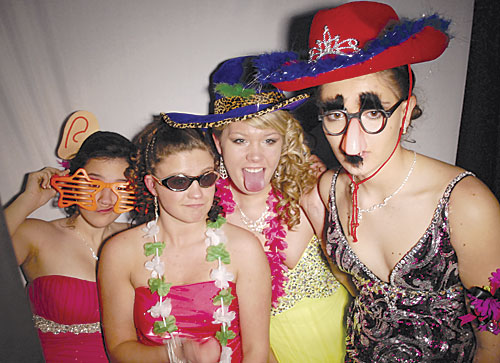 Prom attendees (from left) Kaytlin Laundreaux, Anna Netzer, Natasha Sandland and Ariel Bieber ham it up in the photo booth at the Mobridge Pollock Prom Saturday, April 6.