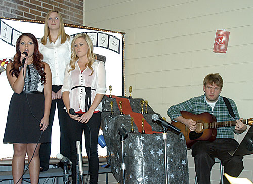 "Soloists Shawna Madison, Makayla Hardcastle and Callie Slater, accompanied by guitaristJohn Bakken, sang a song from ""The Hunger Games."""