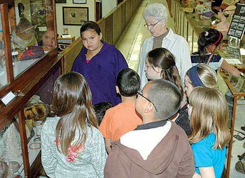 Members of Michelle Wall's third grade class from Dupreevisited Klein Museum, Thursday, May 9, to view thehistorical displays. Volunteers took the class on the tourwhere they learned about life on the prairie, including howto churn butter.