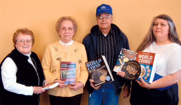 Bridge City Coin and Stamp Club members (from left) Cheryl Maisch, Charlotte Anderson and Lyle Walth recently delivered numismatic books to Karla Bieber of A.H. Brown Public Library. The six volumes cover topics for beginners and specialized to advanced collectors and augment the extensive listing of titles at the library.