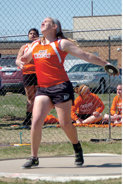 Steph Gemar gives the discus a might heave at the CSDC Meet at Tiger Stadium on Saturday. Gemar went 129-7.25 to in the conference title.