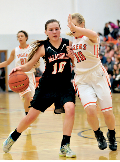 Taylor Brekke plays tight defense on Tiara Flying Horse of McLaughlin at Mobridge-Pollock High School Gym on Thursday. Flying Horse scored 26 points to lead McLaughlin to a 60-58 win over the Lady Tigers.