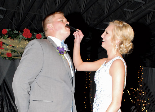 Kylee Wagner (right) combs Carson Keller's mustache during grand march of the 2016 Mobridge-Pollock prom. Sixty  couples attended the event held Saturday night at Mobridge-Pollock High School Gymnasium.