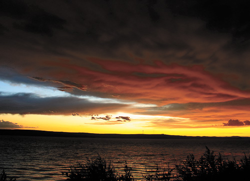 Monday night's brief thunderstorm seemed nearly normal with wind gusts that topped out at 43 mph according to the National Weather Service. As the short-lived storm passed through the area,  the sunset reflected on the remnants of the storm along Lake Oahe.
