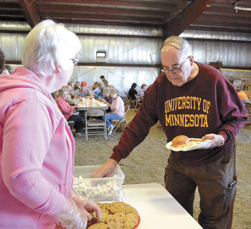 Dr. Herb McClellan (right) tops off his meal with a cookie Saturday, Sept. at the Klein Museum Harvest Festival with the help of volunteer Rozanne Witter of Minnesota. The festival is the annual fundraiser for the museum and is held in conjunction with Beef N Fun Day in Mobridge.  According to Klein Museum Curator Diane Kindt, there were nearly 300 meals served during the event, which is more than were served at the 2015 festival.