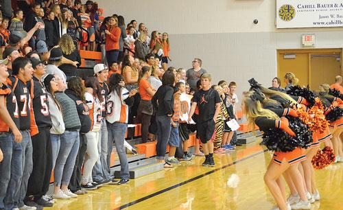 "The Mobridge-Pollock cheerleaders lead the students in the favorite ""Boom shakalaka"" cheer at the pep rally."