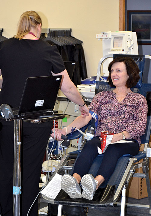 Sherri Vojta of Glenham (left) is one of Blood Heroes who donated blood at the Mobridge Regional Hospital and Clinics drive Tuesday, April 11, at the Family Worship Center. United Blood Services of South Dakota conduct the blood collection services.