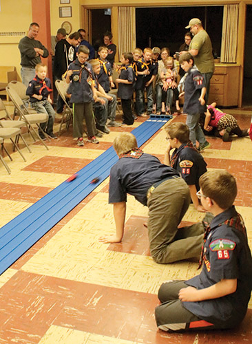 The annual Cub Scout Pinewood Derby competition was held Tuesday, April 4, at Trinity Lutheran Church. Each scout designs, builds and paints his vehicle for the races. Races are run with the members of each den competing against each other. The winners of the den competitions then race for championships.
