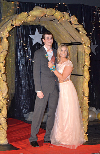 Senior class president Anna Carmody and her date Miles Goldade marked the start of the 2017 prom with the grand march. Nearly 60 couples attended the annual event that included dancing, games, prizes and karaoke. More pictures can be found on page 8 of this issue.